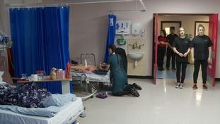 Singing students bring cheer to hospital wards