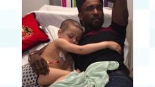 Bradley Lowery cuddles up to his Sunderland hero Jermain Defoe
