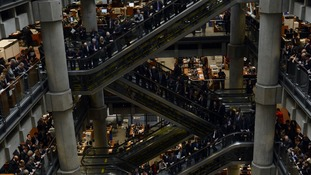 Staff at Lloyd's of London listen to a statement from David Cameron in 2012.