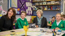 Prime Minister Theresa May sits with year six pupils and Conservative Party candidate for the Copeland by-election, Trudy Harrison.