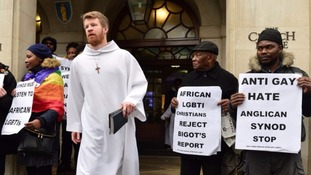 Activists made their stance known as delegates came out of Church House in London.