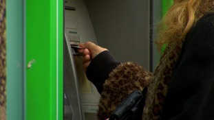 close up person using cash machine