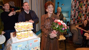 June Brown is given cake and flowers to celebrate her 90th birthday.