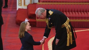 Ellie collects her MBE from Prince Charles