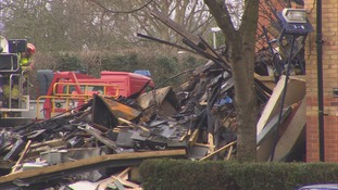 Emergency services work to clear through the rubble