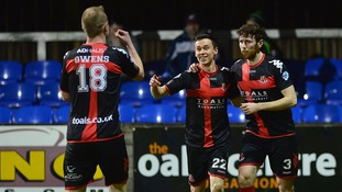 Crusaders beat Dungannon to maintain their lead in the league.