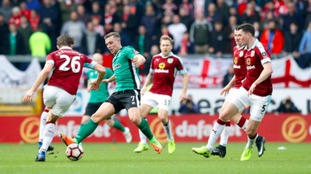 Lincoln's Jack Muldoon in action as he's surrounded by Burnley players