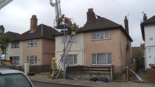 Firecrews search remains of a burnt out house for a body