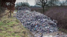 Lorry load of rubbish fly-tipped in country lane