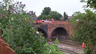 Part of the bridge wall and footpath fell onto the tracks last summer.