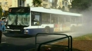 Image on local TV station of bus following reports of explosion in Tel Aviv