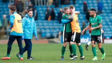 Lincoln City players celebrate after final whistle