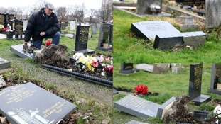 Families heartbroken after dozens of graves vandalised