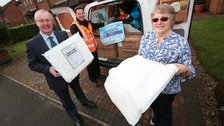 Cllr Robson with Hambleton District Council Street Scene Officer, Alan Scargill,  delivering FloodSax