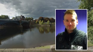 'Hero' police officer saves man after he fell into river