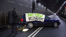 Heathrow arrests as protesters chain themselves to a car