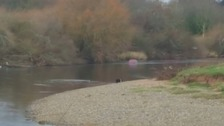 Major search after car found in river