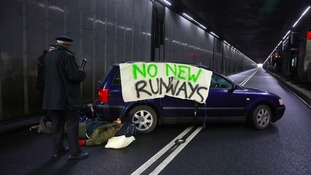 Activists chained themselves to a car in the tunnel