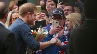Prince Harry greets crowds