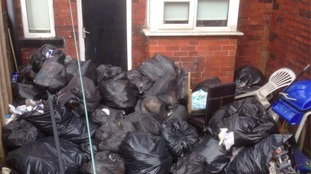 Woman left 'stinking rubbish' to rot in her garden