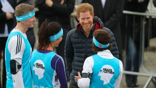 Prince Harry chatting to runners