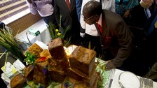President Mugabe blows out the candles on his birthday cake.