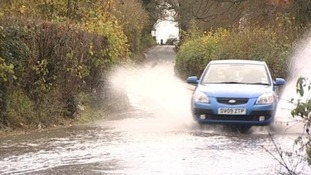 car going through flood
