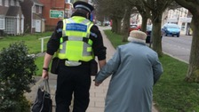 An image of a PCSO helping an elderly woman has gone viral