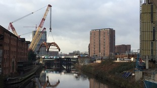 Watch:  600-tonne bridge arches were craned into place