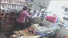 CCTV shows the shop owner's heroic response.