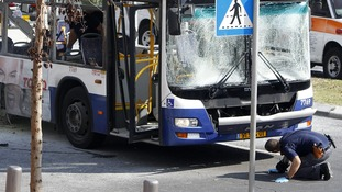 The blast shattered windows as the bus drove along a street next to Israel's Defence Ministry Headquarters