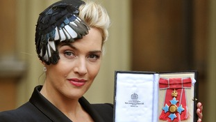 Kate Winslet outside Buckingham Palace with her CBE