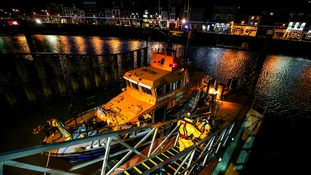 Whitby RNLI volunteer crew launch the all-weather lifeboat to respond to a yacht in difficulties