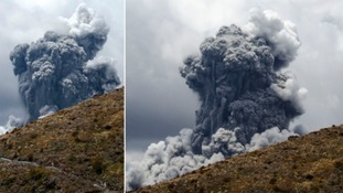 A massive plume of ash billows up into the sky as Mount Tongariro erupts