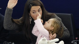 Licia Ronzulli MEP of Italy with her daughter Vittoria during a vote in Strasbourg