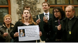 Demonstrators sing during a vigil calling for equality in the church, outside the General Synod of the Church of England