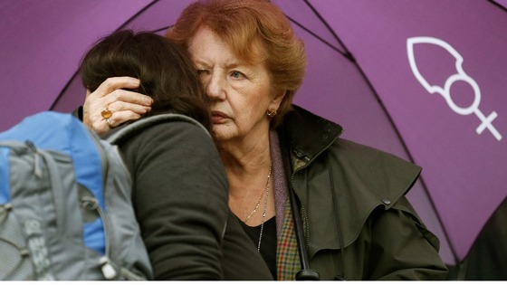 Two women hug during the vigil outside the Church of England's Church House
