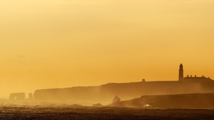 The sun rises over Souter Lighthouse in South Shields