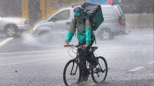 A bicycle courier makes a delivery.