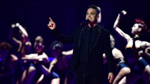 Robbie Williams wins Brits Icon award