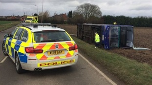 Around a dozen passengers were treated for minor injuries after a bus was blown over.