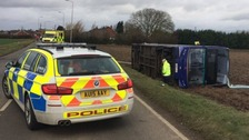 11 people were taken to hospital after a double-decker bus overturned in the Fens.