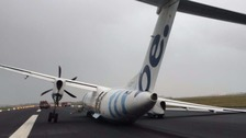 Flybe plane crashes off runway at Schiphol airport