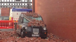 Taxi damaged by wall blown down by Storm Doris
