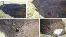Rescue team abseil down sinkhole to rescue dog