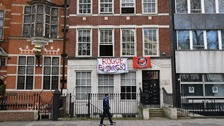 A banner reading 'Rogue Embassy' hangs outside 19 Buckingham Gate, London