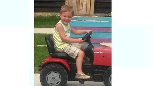 Woman due in court charged in connection with death of toddler killed by dog