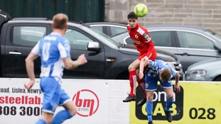 Cliftonville's Jay Donnelly and Coleraine's Lyndon Kane in action.