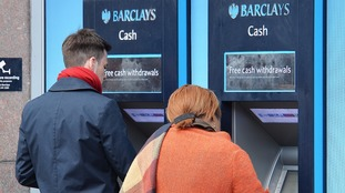 Barclays customers using cash machines