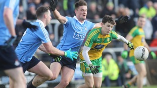 Donegal's Eoin McHugh and Dublin's Eric Lowndes.